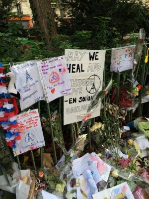 Paris memorial with Oakland sign