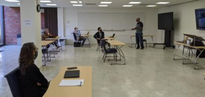Faculty participate in socially distanced training on new classroom equipment.