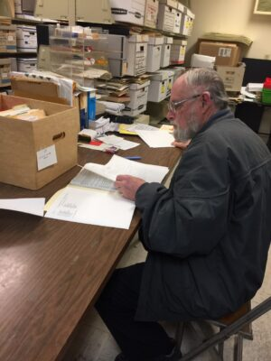 John Rawlinson works in archives