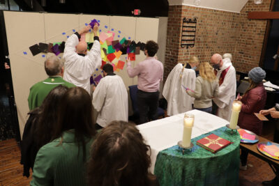 Worship participants make art together during collaborative sermon in All Saints Chapel
